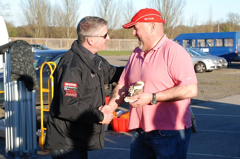 Dave Snelson gets his trophy from ex F1 racer Martin Donnelly